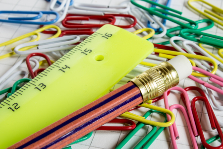 additional training: pencil and ruler with colored paper clips on the training notebook Stock Photo