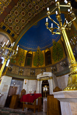 Moscow / Russia - June 21, 2018: Moscow Choral Synagogue, in between the prayers are empty. colorful and solemn interior with bizarre patterns.  Candlesticks in the sanctuary Редакционное
