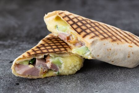 roll with ham, fresh cucumber and cheese. grilled shawarma. stone plate roll