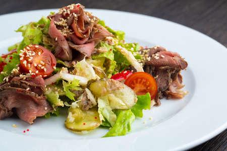Beef salad, Spicy salad of roasted beef, Thai style food, Thai beef salad spicy dish. Stock Photo