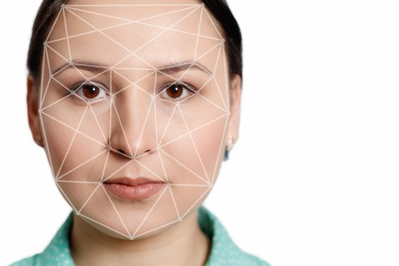 Futuristic and technological scanning of the face of a beautiful woman for facial recognition and scanned person. It can serve to ensure personal safety. Concept of future, security, scanning. Foto de archivo