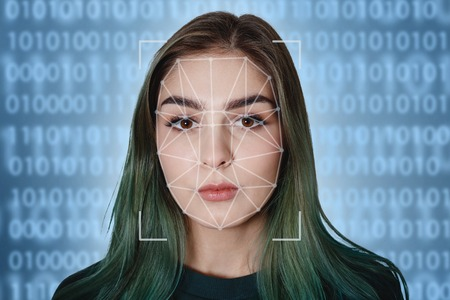 Futuristic and technological scanning of the face of a beautiful woman for facial recognition and scanned person. It can serve to ensure personal safety. Concept of: future, security, scanning. Archivio Fotografico