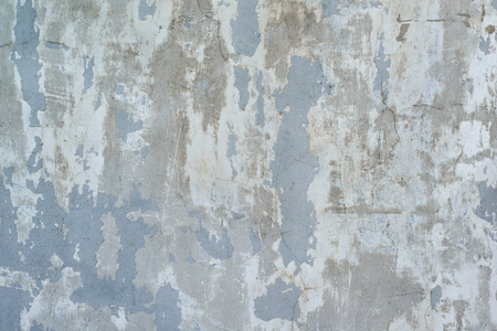 grunge texture of peeling plaster and concrete with cracks