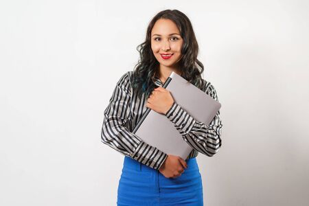 portrait of stylish young woman in blouse, with a laptop in her hands. on white background