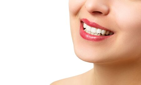the smile of a young woman with perfect white teeth. close-up isolated on white background. place for copy space Archivio Fotografico