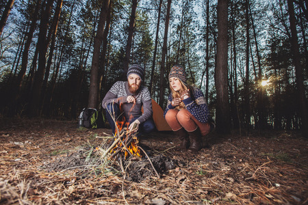 camping tent: Couple tent camping in the wilderness Stock Photo