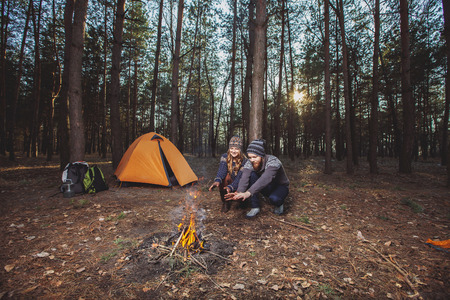 camping: Couple tent camping in the wilderness Stock Photo