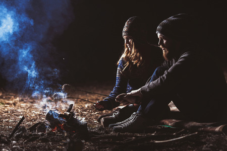 camp fire: Couple tent camping in the wilderness Stock Photo