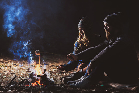 Couple tent camping in the wilderness 스톡 콘텐츠