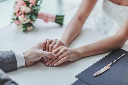 newest: love newest and groom ( the newlyweds) are holding hands Stock Photo