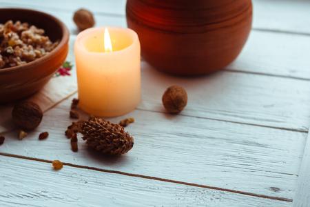 consuetude: Christmas porridge with candles on white wooden background Stock Photo