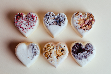 scattered in heart shaped: Beautiful candy in the shape of a heart. Sweet Valentine