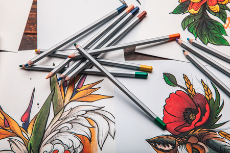 pencil drawings: beautiful sketch drawing flowers with colored pencils lying on old wooden background