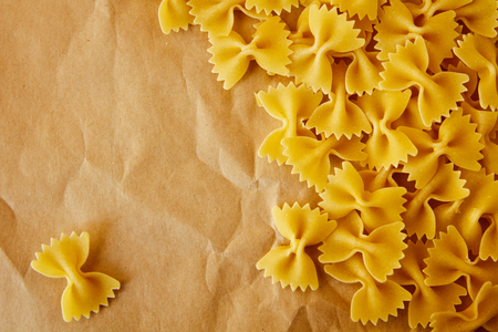 maccheroni: Beautiful background made of pasta ribbons on parchment paper with space for text