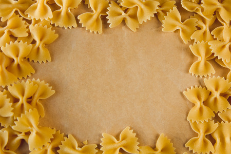 maccheroni: Beautiful frame made of pasta on parchment paper with space for text