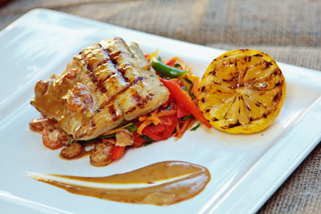 plaice: Baked perch fillet with rosemary and lemon with blanched vegetables Stock Photo