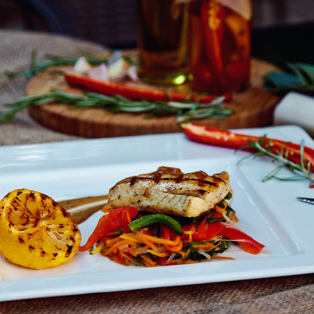 shark catfish: Baked perch fillet with rosemary and lemon with blanched vegetables Stock Photo
