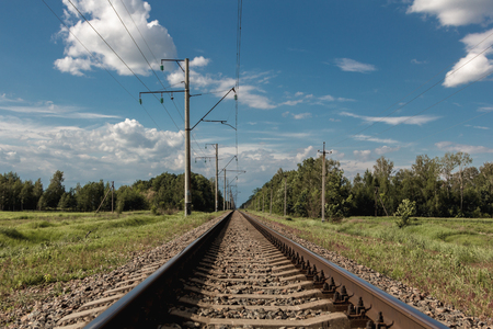 end of a long day: Railroad Tracks on the background of beautiful nature of the Carpathians