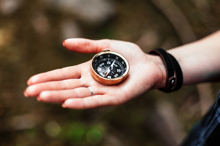 Man holding a compass. Stock Photo