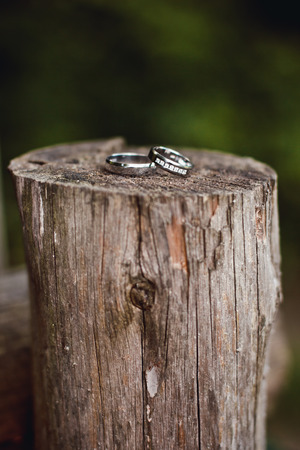 ring stand: Beautiful engagement ring lie on wooden stand