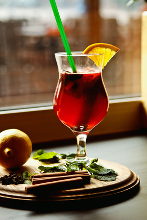 A nice glass of mulled wine with cinnamon sticks, mint and lemon