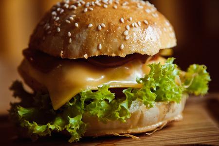 sesame street: beautiful Tasty and appetizing hamburger cheeseburger on wooden background