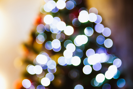 beautiful blurred background Christmas tree in decorated house interior Stock Photo