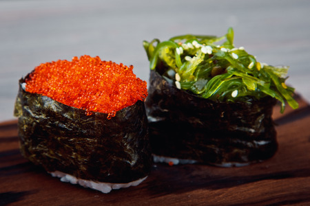 Fresh Sushi Ð¿unkan with caviar and chukoy. Traditional Japanese cuisine. Stock Photo