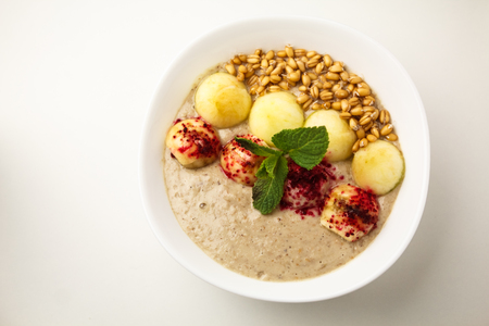 Porridge with apples and sprouted wheat. Theme of raw food, live food, healthy eating background