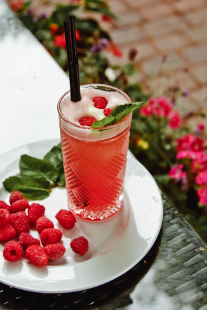 Beautiful fresh cool summer fruit smoothie with raspberries