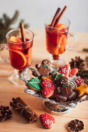 retro christmas: Beautiful Christmas background with mulled wine in a glass, gingerbread and New Year decor Stock Photo