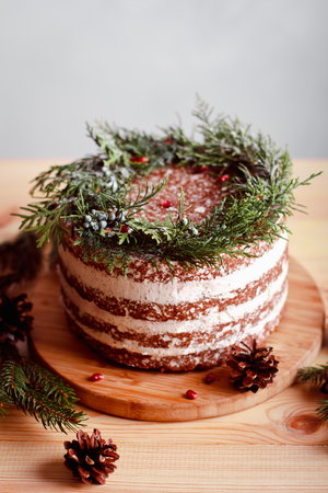 Beautiful decorated cake for Christmas table on New Year background. Preparing for a family celebration