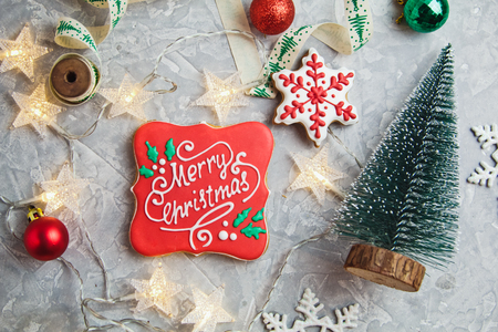 Beautiful Christmas gingerbreads with decor and garland on New Year background. Merry Christmas postcard