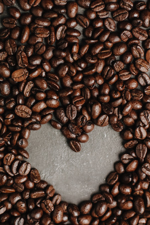 roasted coffee beans, can be used as a background. The concept of Valentine's day. Heart of coffee beans