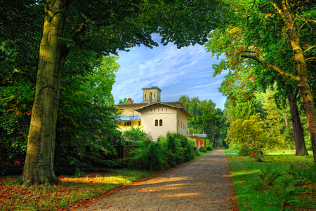 View on Fasanerie summer castle in Potsdam park garden Sanssouci in Podstam city near to Berlin. City garden. Classical Germany architecture famous sightseeing holidays vacations tours. City garden