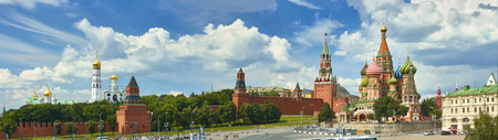 Panoramic view on Moscow Red Square, Kremlin towers, stars and Clock Kuranti, Saint Basils Cathedral. Panorama from hotel Russia. Moscow holidays