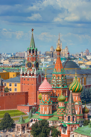 View on Moscow Red Square, Kremlin towers, stars and Clock Kuranti, Saint Basil's Cathedral church. Panorama from hotel Russia. Moscow holidays holiday tours famous sightseeing tours travel