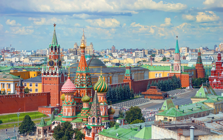 View on Moscow Red Square, Kremlin towers, Clock Kuranti, Saint Basil's Cathedral church, Lenin mausoleum. Panorama Hotel Russia. Sightseeing. Moscow Red Square