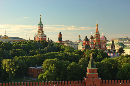 Evening view on Moscow Red Square Kremlin towers red square wall stars and Clock Kuranti Saint Basil Cathedral church. Panorama from bell tower. Moscow holidays back famous sightseeing tours Archivio Fotografico