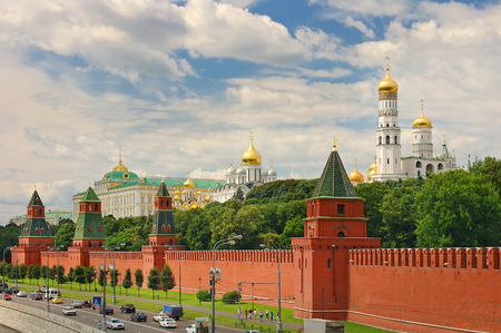 Panoramic view on Moscow Red Square, Kremlin towers stars and Kremlin Palace, Ivan bell tower church. Red Square city park. Red Square, Moscow residence 免版税图像