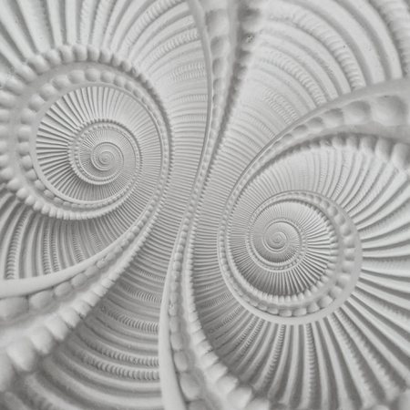 White stucco molding plasterwork element double spiral abstract fractal pattern background. Plaster abstract spiral effect background. White spiral abstract background. Decorative stucco concept