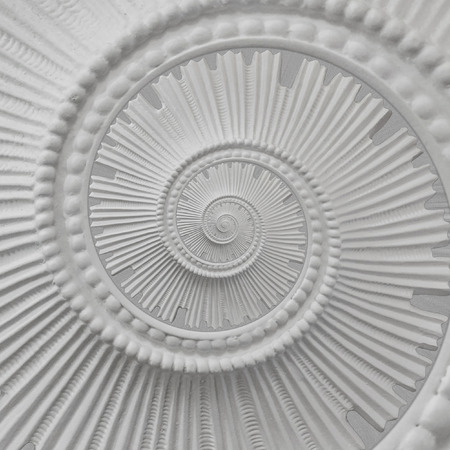 White stucco molding plasterwork spiral abstract fractal pattern background. Plaster abstract spiral effect background. White spiral abstract background. Decorative stucco element concept fractal Archivio Fotografico