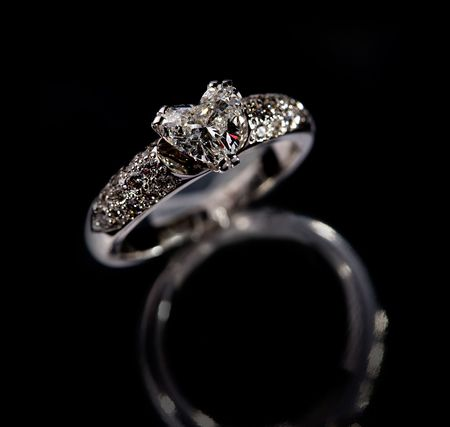 brilliants: Ring with brilliants on a black background Stock Photo
