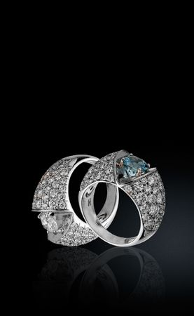 brilliants: Two rings with brilliants on a black background Stock Photo
