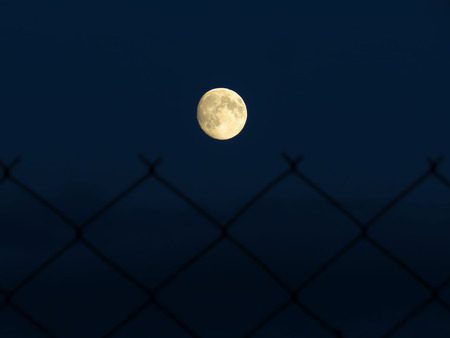 moon over the barbed fence Stok Fotoğraf