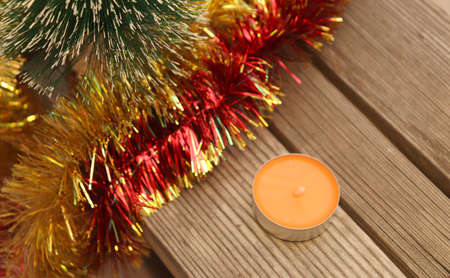 Sparkling bright multi-colored New Year and Christmas tree decorations on an old wooden bench.