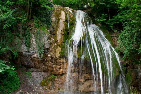 man waterfalls: beautiful waterfall on the sides with plants closeup