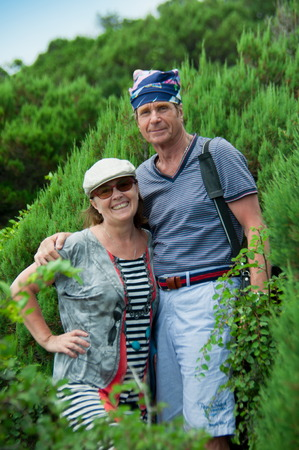 man in the bandana and a woman in a cap on the nature of happiness and fun