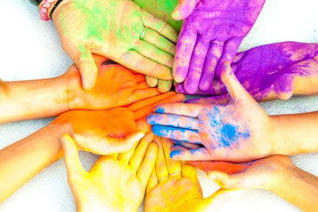 human hands: mens, womens and childrens hands in paint holy Stock Photo