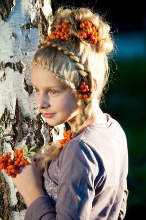 girl near a birch with a beautiful hairstyle with elements rowan Stock Photo